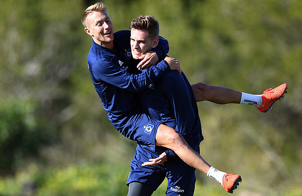 Good vibes: Julian Pollersbeck, celebrating with vice-captain Lewis Holtby in training.